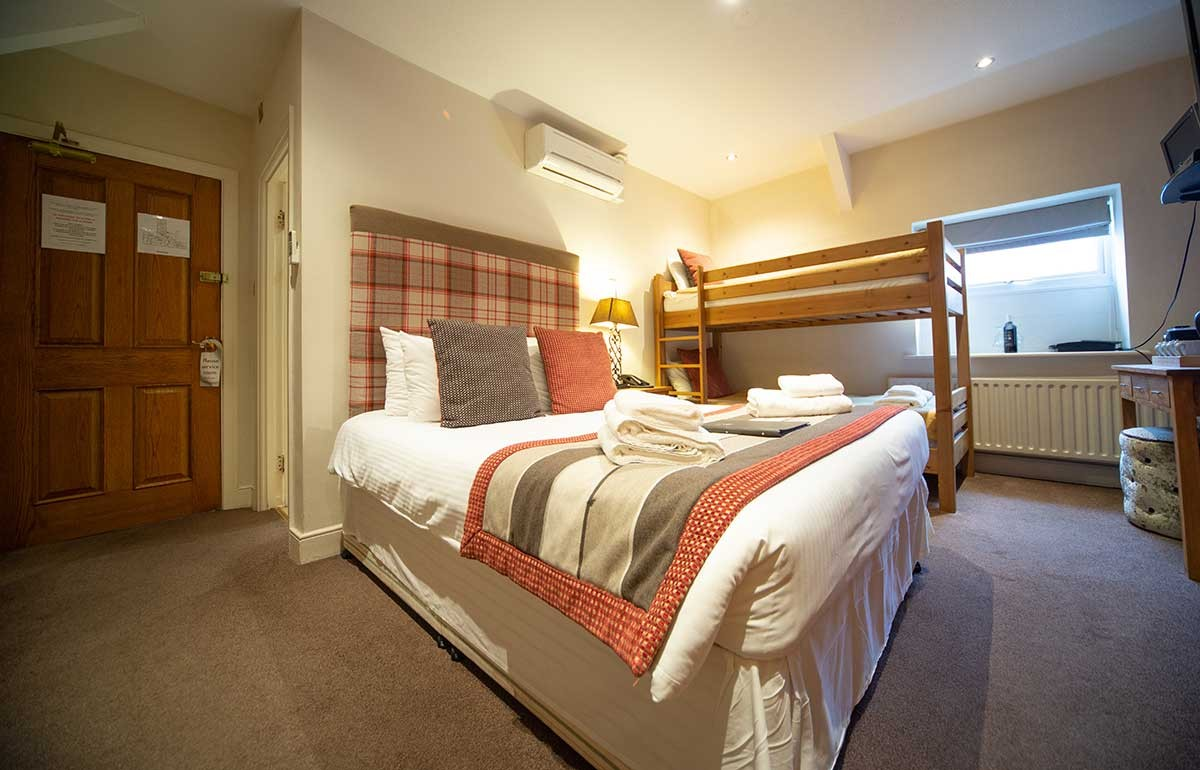 Room 5 bedroom with double bed and bunk beds